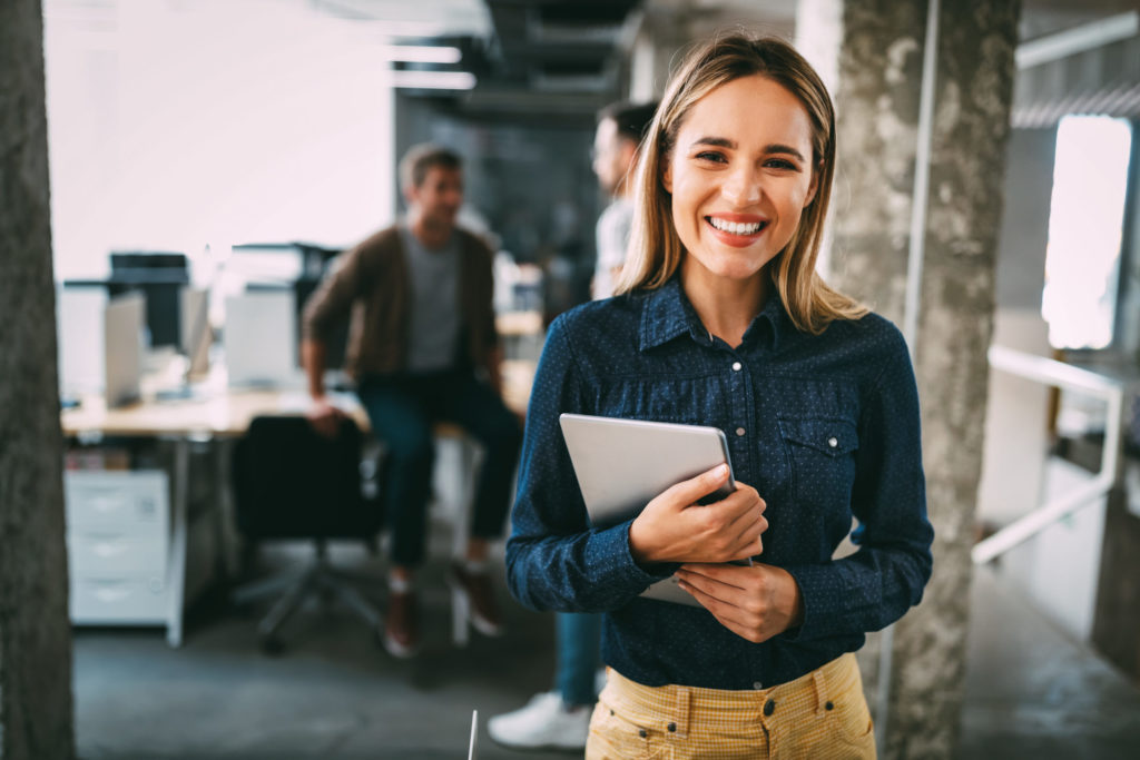 Successful young female employee is happy with her job and career.